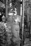 The old broken sculpture in the form of a female torso. In a decorated pavilion royalty free stock photo