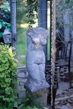 The old broken sculpture in the form of a female torso. In a decorated pavilion royalty free stock photography