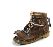 Old and broken shoe. Royalty Free Stock Photos