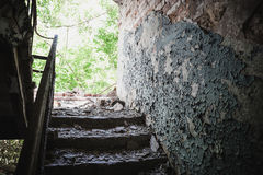 Old broken staircase in rusty ruined abandoned house Royalty Free Stock Photography
