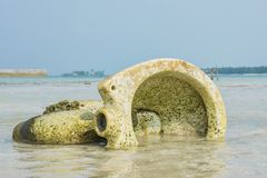 Old broken toilet in the ocean at the tropical beach. In Maldives Stock Photography