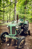 Old broken tractor in the forest Stock Photos