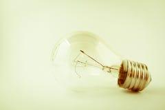 Old broken tungsten light bulb Stock Image