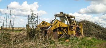 Old broken vintage yellow farm jcb digger Royalty Free Stock Images