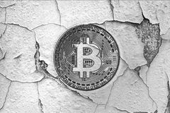 Old broken wall with bitcoin symbol Stock Image