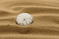 Old broken watch on a sand background Royalty Free Stock Photo