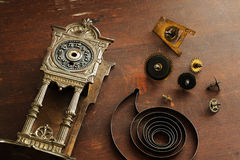Old broken watches and parts for watches. Old broken watches and parts to the clock on a wooden surface Stock Photo