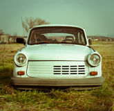 Old Broken White Trabant Car. Front of an old broken trabant car Stock Photos