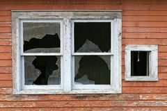Old broken window. An old, broken window on a wooden home ca. 1940s royalty free stock image