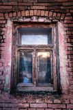 Old broken window on an abandoned old building. Royalty Free Stock Photo