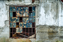 Old broken window. In gray concrete wall stock images