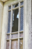 Old broken window. In an old house Royalty Free Stock Image