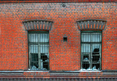 Old broken window on red brick wall Stock Photography
