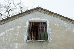 Old broken window on ruin house. Stock Photography