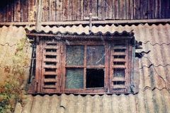 Old broken window. Old scratched grungy photograph of broken wooden window stock images