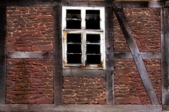 Old broken window in the wall of old house Royalty Free Stock Photos