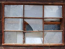 Old Broken Windows. Wooden frames. Dirty and broken glass. Abandoned house Stock Images