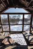Old broken wooden balcony and the view of beautiful wild winter nature. Through it stock images