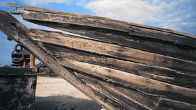 Old broken wooden boat standing on the morning sea beach stock video