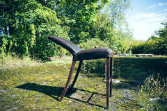 Old broken wooden chair Stock Image