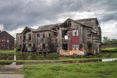 Old broken wooden house on the outskirts of the city Stock Photo