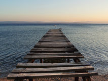 Old broken wooden pier on sunset Royalty Free Stock Photo