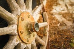 Old broken wooden wheel. Like a decoration on the wall of retro wooden house stock images