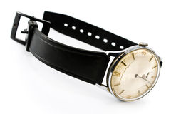 Old broken wristwatch with black strap Stock Photography