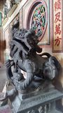 Old Bronz lion the guardian of a Chinese shrine in Tarad Noi community on Chaopraya River side in Bangkok Stock Image