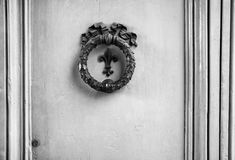 Old bronze architectonic element on a door in Florence, italy (black and white).  royalty free stock photography