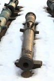 Old bronze cannon on snow royalty free stock photo