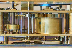 Old bronze clock mechanism Royalty Free Stock Image