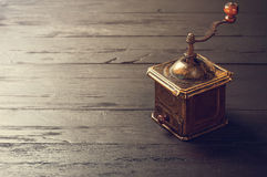 Old bronze coffee mill on black wooden board Stock Images