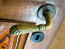 Old bronze door handle in the form of animal paws Stock Image