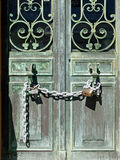 Old Bronze Doors Secured With Lock and Chain Royalty Free Stock Photos