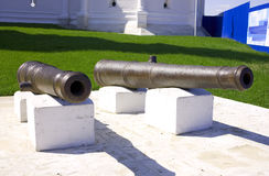 The old bronze guns. The old bronze cannon of about the walls of the monastery Royalty Free Stock Photography