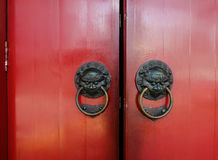Old bronze knocker with red door. In Chinese temple Royalty Free Stock Photo
