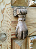 Old bronze knocker on a wooden door Royalty Free Stock Images