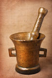Old bronze mortar. And pestle on sacking background royalty free stock photography