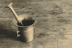 Old bronze mortar with pestle on wootden table Stock Photography