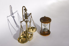 Old bronze scale and an hourglass (Slow Justice) Stock Image