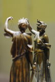 Old bronze statue of Justice. In front of mirror stock images