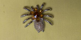 Jewelry designed in the form of spider. Old brooch in the form of the spider decorated with stones Royalty Free Stock Image