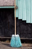 An old broom against the old wall Royalty Free Stock Image