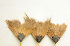 Old broom or besom. On the gray wall Royalty Free Stock Images
