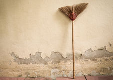 Old broom and grunge cement wall Stock Images