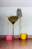Old broom and old mop Royalty Free Stock Photos