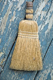 Old Broom on Painted Boards Royalty Free Stock Images