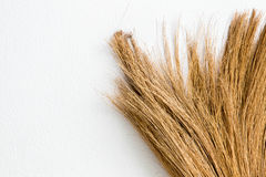 Old broom put on the wall Royalty Free Stock Photo