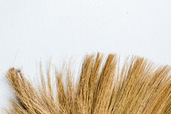 Old broom put on the wall Royalty Free Stock Image
